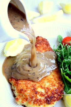 Chicken schnitzel with gravy recipe for a classic Australian style schnitzel. An easy recipe using pounded chicken breasts and coated with panko breadcrumbs. Chicken Shnitzel, Chicken Gravy, Australian Food, Australian Recipes, Great Recipes, Dinner Recipes, Pub Food, Specialty Foods, Copycat Recipes