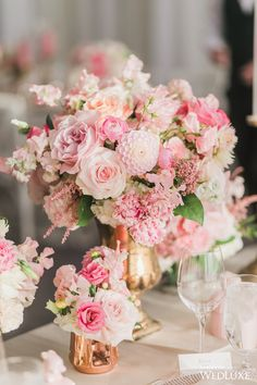 Shades of pink | WedLuxe – Carousel Ride | Photography by: Rhythm Photography Follow @WedLuxe for more wedding inspiration! #wedluxe #wedluxemagazine #weddingdecor #weddinginspo #flowers #weddingflowers #tabledecor