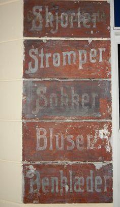 ghost sign from 1921 Peter Herman Jacob Jensen & Mrs. Johanne Margarita had retailshop here