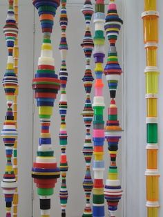"""Artist Mary Ellen Croteau is showing these columns made from recycled plastic cartons and lids in the window of the Columbia College bookstore on Michigan Avenue. They are a playful homage to Brancusi's """"Endless Columns"""", with a serious environmental message for our times:"""