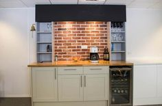 Coffee shop inspired office kitchen with brick tiles, shaker style units, wooden worktop and chalkboard feature. www.jbhrefurbishments.co.uk