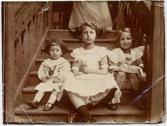 turn of the century photo of children posed on the stairs