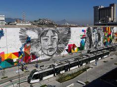 Grafiteiros trabalham em um mural com imagens que caracteriza os povos nativos dos cinco continentes antes dos Jogos Olímpicos Rio 2016 no Boulevard Olímpico, no Rio de Janeiro (Foto: Bruno Kelly/Reuters)
