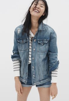 madewell oversized jean jacket worn with the striped dockline sweater + westside high-rise jean shorts.