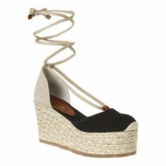 """Canvas and rope closed toe espadrille.  Rope covered heel and platform.  Measurements: wedge 3.5"""" wedge and platform 2""""."""