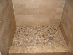 Pebble Tiles for Shower Floor   porcelain tile shower with multiple patterns river stone shower floor