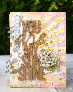 chipboard mini album cover with chipboard sentiment spray painted and UTEE'd.