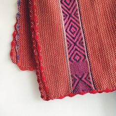 It's all about the details like the hand-knit scalloped edges of this one-of-a-kind beauty.  Happy that it's found a new home in a sweet little baby's nursery. #Cambie #Design #Peruvian #Rug #Peru #Handmade #Handwoven #Wool