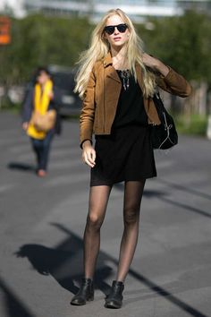 ELLE loves... street-style inspiration from the off-duty models around Paris Fashion Week.   A simple little black dress is given a boho twist with a tan suede jacket and dreamcatcher necklace.