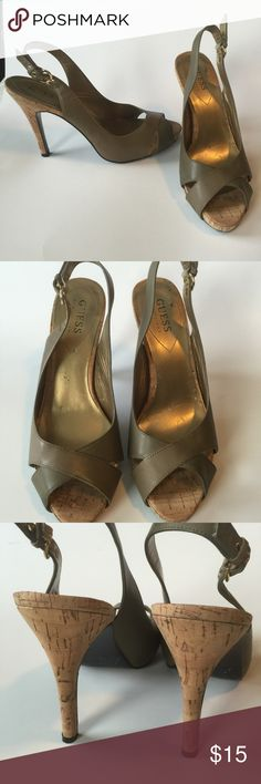 """Guess sling backs These leather sling back heels have a 4.5"""" cork heel with a half inch platform.  The color is between an army green and a brown.  Last picture shows a small water stain.     (Item 144) Guess Shoes Heels"""