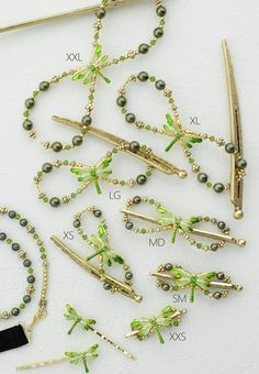 Lilla Rose Inc - Flitter the fascinating dragonfly is alive with refreshing shades of vibrant greens and gold and finding rest on the lavish arrangement of shimmering glass and crystal.