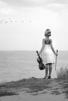 She has been playing since she was a child. Standing in a white dress by the ocean with a violin watching birds fly by.