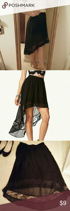 Gorgeous high-low skirt!! Flowy black skirt that is high in front and runs long in the back. High waisted with a side zipper and clasp. Lace lines the bottom of the skirt. This beauty is sheer with a black lining that stops about mid thigh. Needs a great home!! Forever 21 Skirts High Low