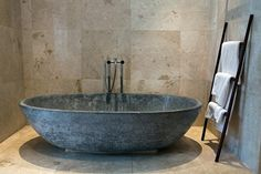 Home design, Large Bathtub Made From Stone In Ceramic Wall Bathroom Balinese Style: contemporary balinese home design with small space