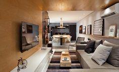 Na hora de decorar os apês dos dois irmãos, o escritório Conrado Ceravolo Arquitetos criou dois ambientes que nem parecem ter o mesmo layout