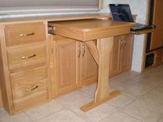 pull out dining table  | On the right, there is a pull out tray for her laptop computer, and ...