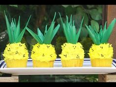 My Cupcake Addiction - Elise Strachan  Pineapple cupcakes  Adorable!!! The leaves on top are green colored chocolate - so clever!