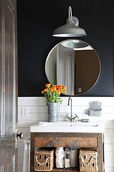 barn light in bathroom. I like the look of the round mirror under it. Half Bath.