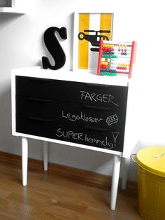 Chalkboard paint for a chest of drawers (paint Knut's grandpa's desk yellow and  use black chalkboard paint for the doors)
