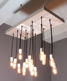 industrial chandelier with 16 pendants, white porcelain sockets and new Torch style Edison bulbs