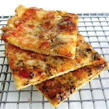 """St. Louis-style Pizza.  With its cracker-thin baking powder crust and square slices, there are those who'd claim this dish isn't in fact a pizza. But to residents of St. Louis, it's one of their city's culinary icons. And before you dismiss it out of hand — try it. Any pizza that can go from """"Hmmm, I need a snack"""" to hot on your plate in 20 minutes is worth trying at least once!"""