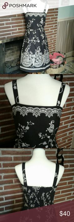Black and White Sundress Madison Leigh Sundress.   Tailored black with white scrolls.  Adjustable straps and pleated skirt.  Zippered back with elastic.  Vintage look, but new.  Can be worn with sweater or blazer for work, without for day time.  Stunning. madison leigh Dresses