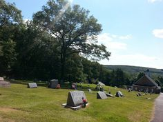 High on the hill. Cemetery to the rear and forest on the other sides.