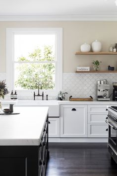 This is the kind of small tile we like for the splash back - our space is similar we thought, with the window to work around.