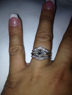 Beautiful princess cut with trillions and enhancer wedding band I love the vintage look of my set!