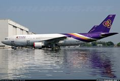 One of two Airbus A300s (the other being HS-TAL) left behind at Don Muang Airport when it was flooded.  The landing gear and engine nacelles have been bagged to protect them.  At it's highest level it appears the water was about a foot above the bottom of the engine nacelle.  Now going on three weeks sitting in the water. - Photo taken at Bangkok - International (Don Muang) (DMK / VTBD) in Thailand on November 16, 2011.