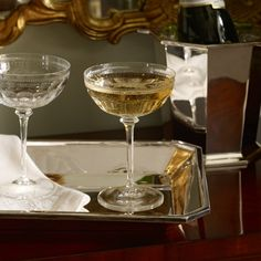 Featuring elegant beveling our Edwardian-inspired Dagny Champagne Saucer is made by one of the leading mouth-blown- and hand-cut-crystal facilities in the world. Champagne Saucers, Wine Goblets, Modern Luxury, Barware, Ralph Lauren, Entertaining, Tableware, Kitchenware, Dining