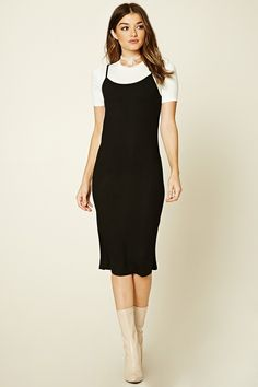 A ribbed knit dress featuring a midi length and cami straps, as well as a contrast underlayer with short sleeves and a round neckline.