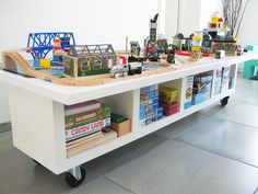 train table hack -table top on a Kallax single wide unit with casters!  This would be so cool for the loft!