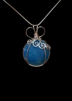 Blue Dragon Vein Agate Cabochon Handmade Wire Wrapped Pendant. $39.95, via Etsy.