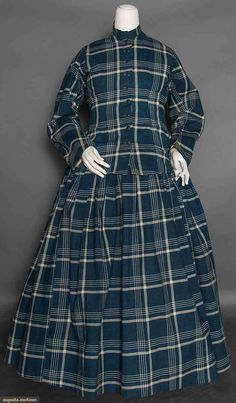 "INDIGO PRINT MATERNITY? DRESS, 1860s WORK DRESS?  April 8, 2015 NYC New York City  2-piece dark indigo & white plaid, loosely fitted jacket, CF buttons, gathered long skirt, left side seam pocket, B 36"", Skirt W 41"", Skirt L 34"", cream cotton jacket lining & waistband, blue printed hem facing, B 36"", Jacket W 33.5"", Skirt W 41"", Skirt L 34"", (1 missing button, some scattered tiny holes) very good. Strong Museum, Rochester."