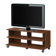 BENNO TV unit with casters IKEA Casters included for easy mobility. Open back; makes cable organizing easy. unit hamptons IKEA US - Furniture and Home Furnishings Coffee Table Inspiration, Pallet Tv Stands, Entertainment Table, Ikea Us, Tv Unit, Apartment Living, Living Room Furniture, Home Furnishings, Black And Brown