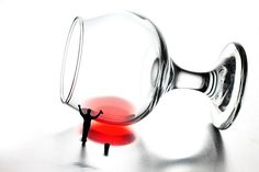 Cleaning wine cup, little people on food, creative photography, miniature art, macro, micro, HO scale, red, glass, home decor, wall art, gift choice. By Paul Ge.
