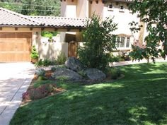 """Large boulders, a new driveway, walk-ways, custom gates and strategically placed plants, shrubs and trees were added. It is the small details that really create that """"distinct"""" curb appeal that will make your home a show-stopper!"""