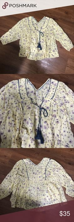 Yellow free people baby doll top Yellow free people baby doll top with adorable blue tassels and stitching Free People Tops Blouses