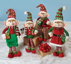 Christmas 4 Piece Elf Family Decor SetElf family assortment with two sitting and two standing. Girl standing elf with red Santa dress and green hat. Boy standing elf with Elf Christmas Decorations, Christmas Signs, Holiday Ornaments, Christmas Holidays, Christmas Crafts, Holiday Decor, Family Christmas, Elf Toy, Diy Crafts
