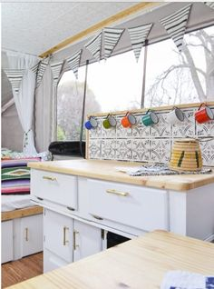 Pop-Up Camper Remodel Reveal This camper is full of DIY projects - you'd never believe how it looked before. Pop up camper remodel with an eclectic vintage boho feel via Refresh Living.