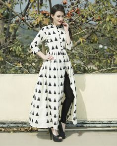 Buy The Secret Label Off White Cotton Printed Front Cut Kurti online in India at best price. Classy and chic, this white triangular ikat cape is sure make heads turn. Comes with a mandarin coll Kurta Designs Women, Blouse Designs, Front Cut Kurti, Ikkat Dresses, Printed Kurti, Kurti Designs Party Wear, Mode Hijab, Dress Cuts, Indian Designer Wear