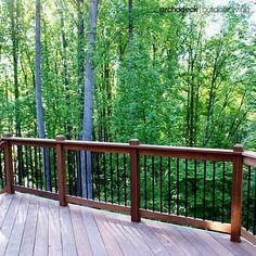 Massaranduba hardwood dominates the design of this traditional deck while slender metal balusters shift the style toward modern too.