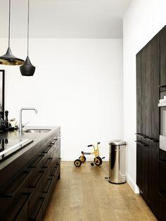 minimal kitchen with black pendants