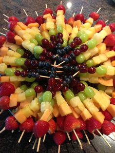 craving station: Beautiful rainbow fruit kabobs + crack dip. tie dye fruit plate  use blunt sticks