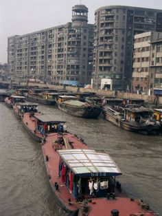 Suzhou Creek, Shanghai, China.  Will never forget watching these little boats on the river in the pouring rain.