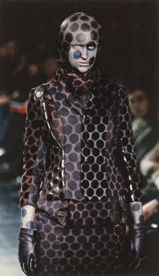 cotonblanc:    brown jacket, top, skirt, scarf, gloves and boots of various fabrics including wool, cotton and rayon/polyester, printed with black dot patternfall–winter 2000–2001, undercoverism  future beauty: 30 years of japanese fashion