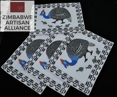 """Black and White Guinea Fowl Print Placemats"" Zimbabwe Textiles  Set of 4 hand printed African placemats.  These placemats are hand printed by Zimbabwean women who work from  home. Their wares are then sold at the Avondale Market in Harare, Zimbabwe.  This set was made by the artist Patricia."
