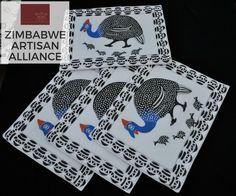 """Black and White Guinea Fowl Print Placemats"" Zimbabwe Textiles  Setof4 hand printed Africanplacemats.  TheseplacematsarehandprintedbyZimbabweanwomenwhoworkfrom home. TheirwaresarethensoldattheAvondaleMarketinHarare, Zimbabwe.  This set was made by the artist Patricia."