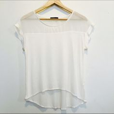 Sheer white top Cute, light weight, flowy, white top. Longer in the back. Size small. Fun, versatile top!! Tops Tees - Short Sleeve